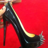 Photo taken at Christian Louboutin by Catherine C. on 8/3/2012
