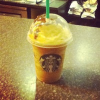 Photo taken at Starbucks by Lorena A. on 4/19/2012