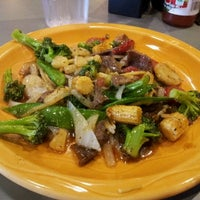 Photo taken at HuHot Mongolian Grill by Shanda J. on 5/30/2012