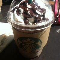 Photo taken at Starbucks by som z. on 4/14/2012