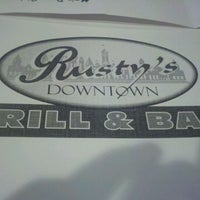 Photo taken at Rusty's Downtown Grill & Bar by Bob J. on 1/10/2012