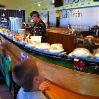 Photo taken at Sushi Train by Becky D. on 8/30/2012