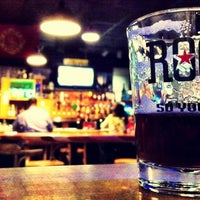 Photo taken at Rogue Ales Public House & Brewery by Andrew R. on 12/2/2011