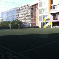 Photo taken at Bina bangsa school stadium by Maxie N. on 7/22/2012
