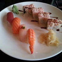 Photo taken at Sushi Raku by Kaleb F. on 9/11/2012