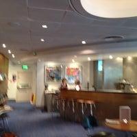 Photo taken at Virgin Atlantic Revivals Lounge by Alexandra N. on 10/31/2011