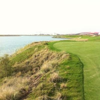 Photo taken at Yas Links Golf Course by Hyuck Soo L. on 5/5/2012