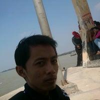 Photo taken at Pantai Boom Tuban by Eddy S. on 8/22/2012