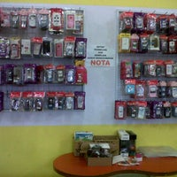 Photo taken at Top Reload Shop by Niena L. on 2/6/2012
