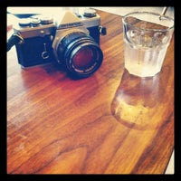 Photo taken at TINT CAFE by _ K. on 4/22/2012