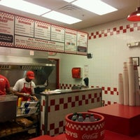 Photo taken at Five Guys by Adrian T. on 5/5/2012