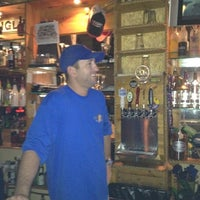 Photo taken at Conch Town Liquor & Lounge by Chris B. on 10/17/2011