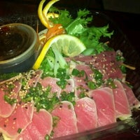 Photo taken at Bluefin Sushi & Thai Grill by Adam T. on 10/27/2011
