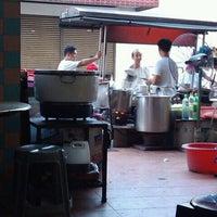 Photo taken at Kampung Malabar Porridge by Mike Siew on 1/16/2012