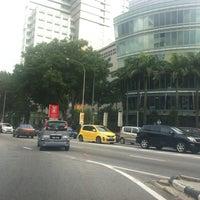Photo taken at Simpang Jalan Ampang & Jalan Jelatek by AZURA on 8/28/2012