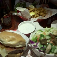 Photo taken at Red Robin Gourmet Burgers by Attilio F. on 12/8/2011