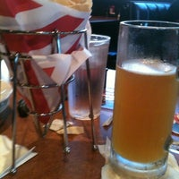 Photo taken at TGI Fridays by Kim S. on 9/1/2012