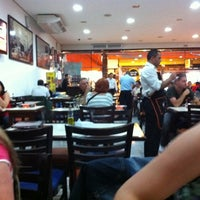 Photo taken at Surf's Pizzaria & Restaurante by Thiago C. on 10/9/2011