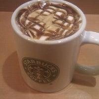 Photo taken at Starbucks by Sukh D. on 9/18/2011