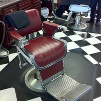 Photo taken at Gino's Classic Barber Shoppe by Cooper G. on 7/19/2011