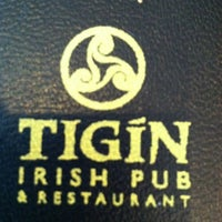 Photo taken at Tigín Irish Pub & Restaurant by Alexander H. on 4/23/2012