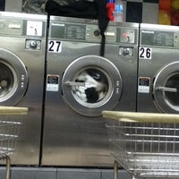 Photo taken at Happy Soap Laundromat Corp. by Ryan D. on 7/21/2012