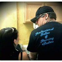 Photo taken at Scratch The Surface Tattoo And Body Piercing by Stephanie F. on 8/4/2011