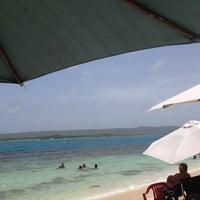 Photo taken at Cayo Peraza by Yamileth on 7/7/2012
