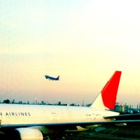Photo taken at Gate 11 by Sachiko I. on 6/24/2011