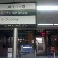 Photo taken at Gate C23 by Scott C. on 3/21/2012