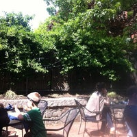 Photo taken at Four Restaurant by Dan C. on 5/20/2012