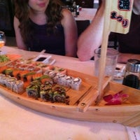 Photo taken at Blue Moon Asian Grill & Sushi Bar by Amber L. on 7/9/2011