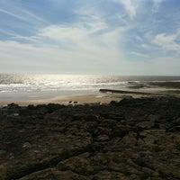 Photo taken at Porthcawl Beach by Sarah J. on 6/26/2012