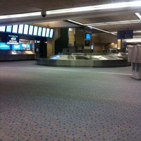 Photo taken at Gate E14 by Aaron G. on 9/21/2011