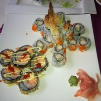 Photo taken at Sushi Cafe by Victor A. on 5/29/2012