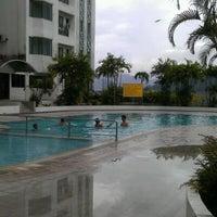 Photo taken at Swimming Pool Likas Square by Gates O. on 12/17/2011