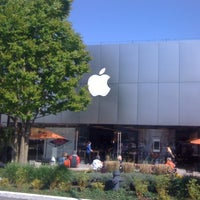 Photo taken at Apple University Village by Cristian M. on 4/18/2012