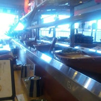 Photo taken at Umi Sushi Boat by Enrique D. on 7/12/2012