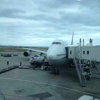 Photo taken at Gate 35 by Yoichi M. on 2/3/2012