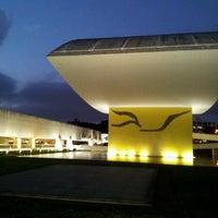Photo taken at Estacionamento Museu Oscar Niemeyer by Alexane S. on 8/29/2012