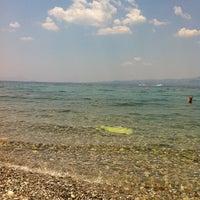 Photo taken at Vlastos beach by Stelios K. on 7/8/2012