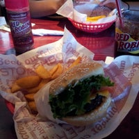 Photo taken at Red Robin Gourmet Burgers by Dimetri P. on 8/7/2012