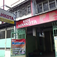 Photo taken at Kios Mahkota by Tjuntaraga on 4/2/2012