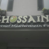 Photo taken at Ghossains Gourmet Mediterranean Foods by Joshua N. on 8/11/2012