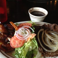 Photo taken at Papi's Cuban & Caribbean Grill by Coco H. on 5/18/2012