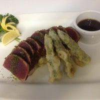 Photo taken at Mizu Japanese & Thai Cuisine by Mizu R. on 6/11/2012