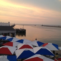 Photo taken at Gosman's Topside Bar by Ellie R. on 8/8/2012