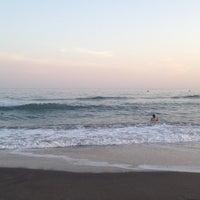Photo taken at Playa Ferrara by Pedrito P. on 7/24/2012