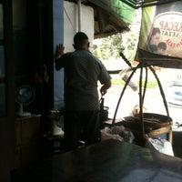 Photo taken at tongseng pak budi condet by Andree S. on 2/19/2012