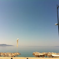 Photo taken at ammos beach bar by Gina S. on 6/10/2012